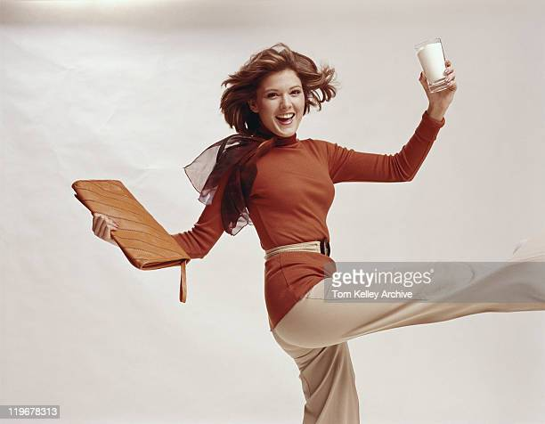 woman holding glass of milk and file, smiling, portrait - 1975 stock pictures, royalty-free photos & images