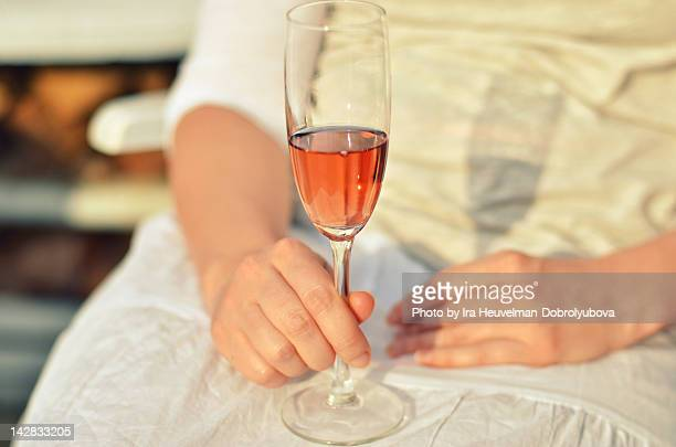 Woman holding glass of rose wine