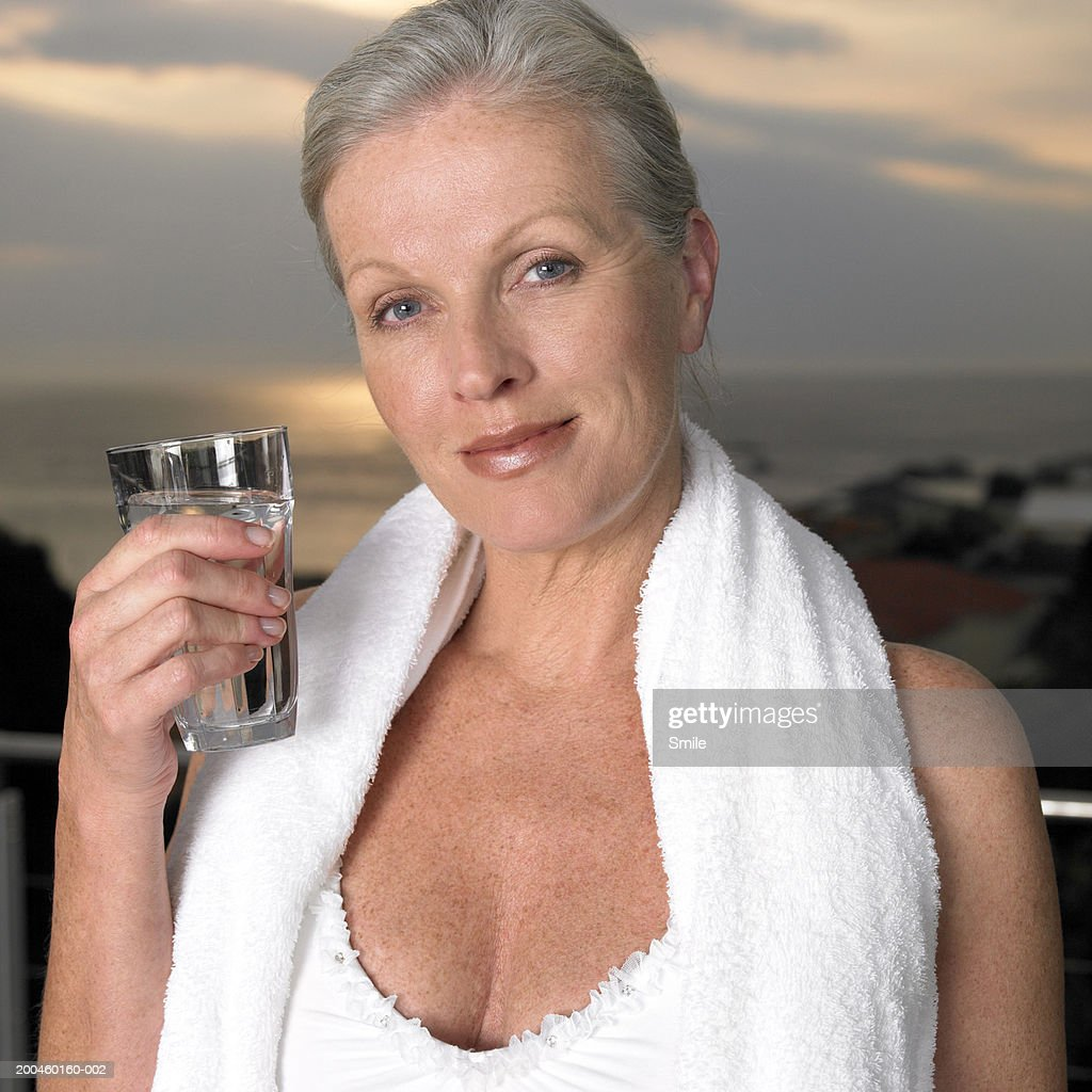 Woman Holding Glass Of Water Portrait Stock Photo  Getty Images-3252