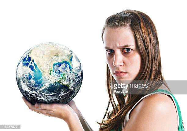 Woman holding globe looks angry: perhaps at state of world
