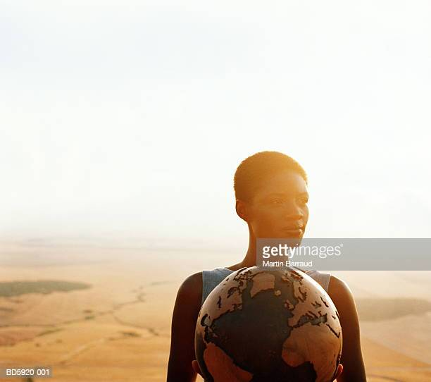 woman holding globe, outdoors, portrait - world kindness day - fotografias e filmes do acervo