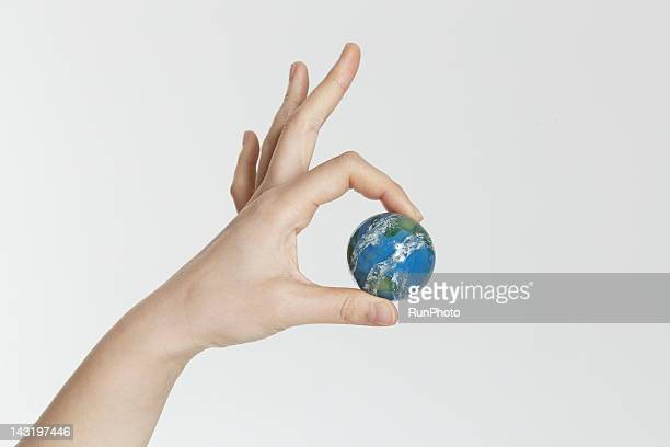 woman holding globe,hand close-up