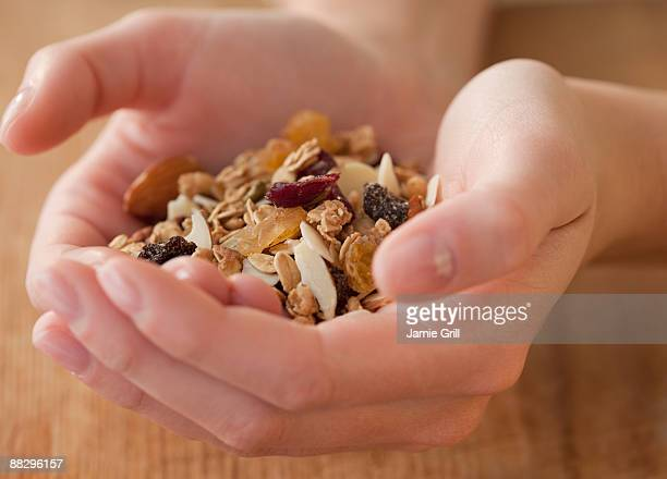 Woman holding granola in hands