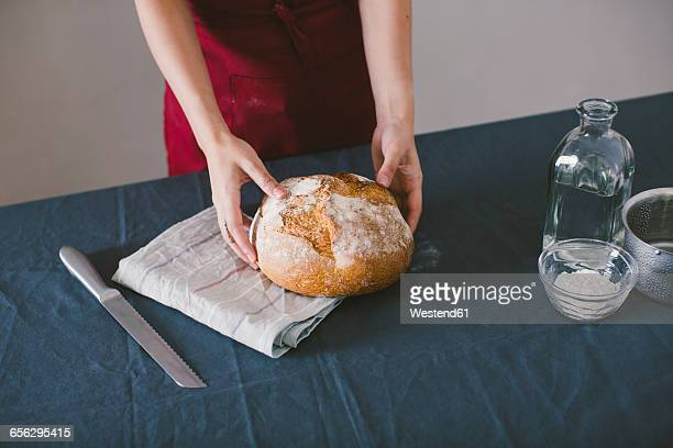 Woman holding hand made bread