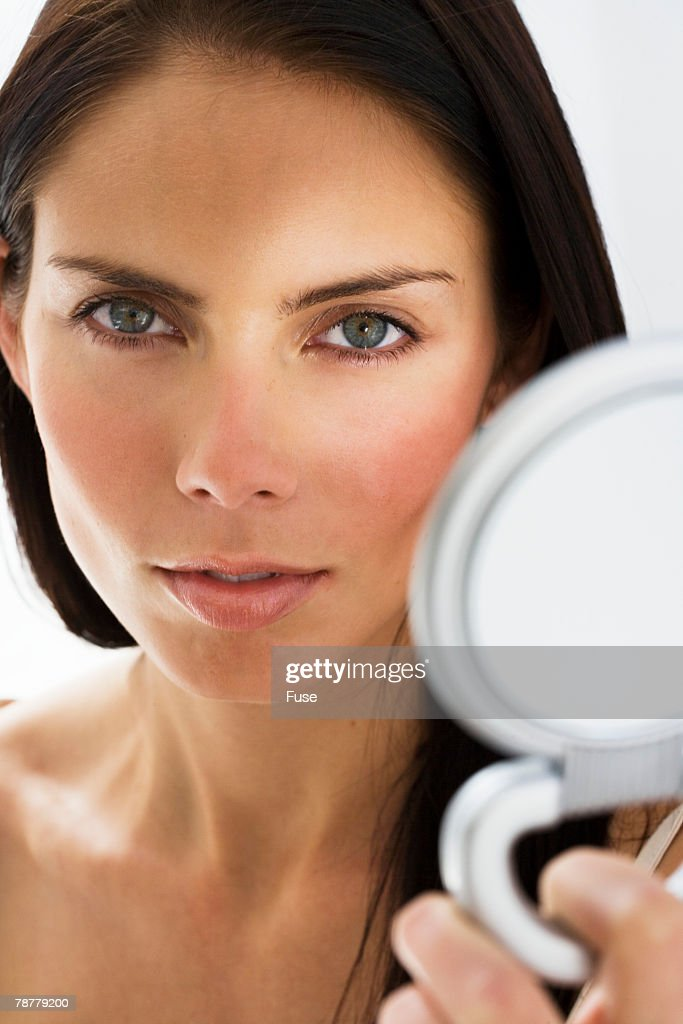 woman holding hand mirror. Woman Holding Hand Mirror : Stock Photo