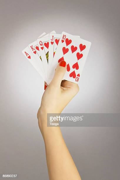 Woman holding hand of cards