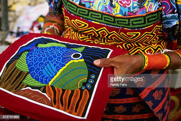 woman holding handcrafted mola - mola stock pictures, royalty-free photos & images