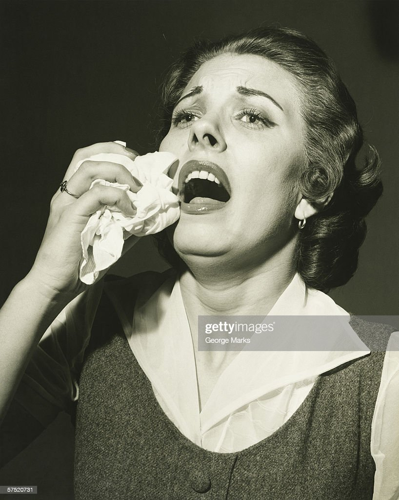 Woman holding handkerchief about to sneeze, (B&W), close-up : Stock Photo