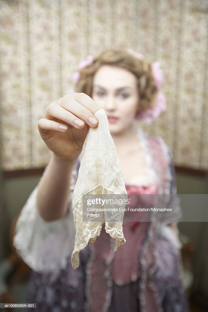 Woman holding handkerchief, focus on foreground : Foto stock