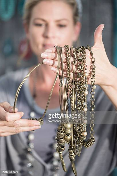 Woman holding handmade necklaces