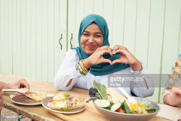 woman holding hands in heart shape - healthy eating stock pictures, royalty-free photos & images