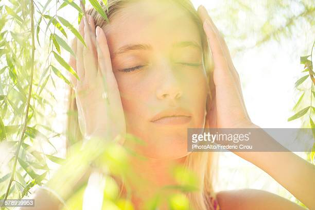 woman holding head, portrait - homeopathic medicine stock photos and pictures