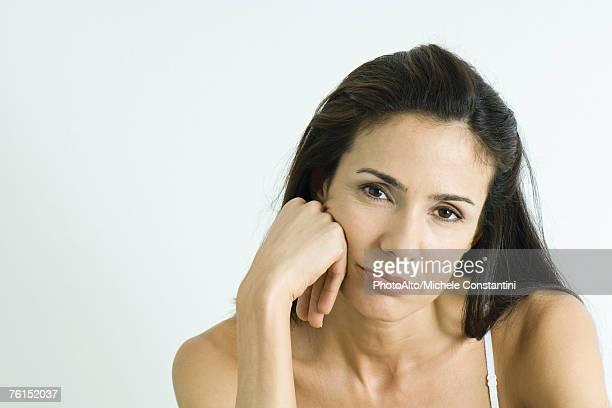 'Woman holding head, pouting, portrait'