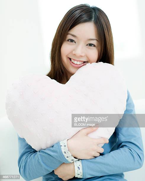 Woman Holding Heart Shaped Cushion