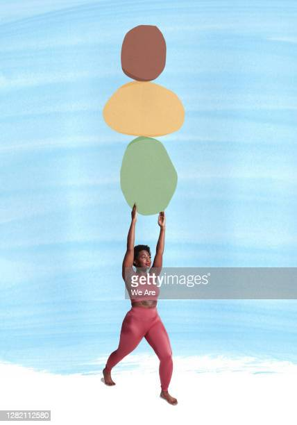 woman holding heavy stones - black culture stock pictures, royalty-free photos & images