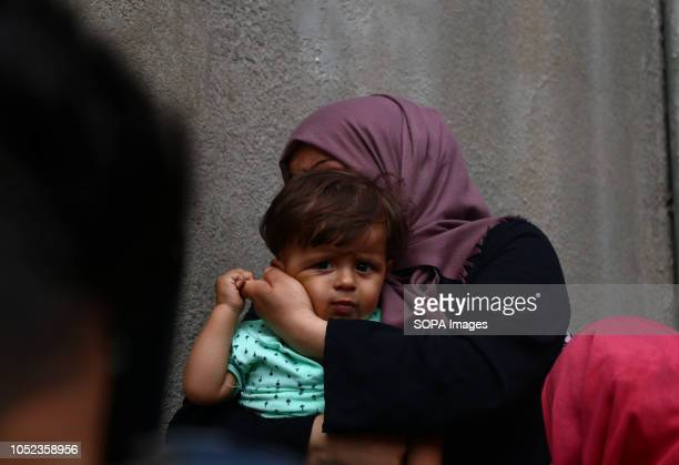 A woman holding her child seen crying during the funeral of martyr Naji Jamal alZa'anin Naji Jamal alZa'anin 25 years old was killed by an Israeli...