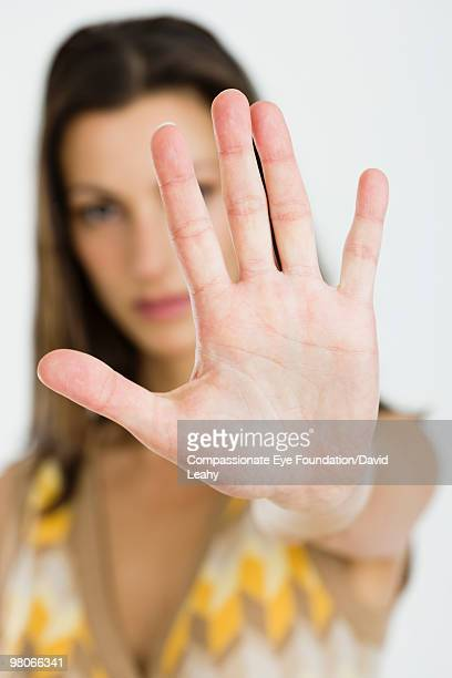 "woman holding her palm out  - ""compassionate eye"" stock pictures, royalty-free photos & images"