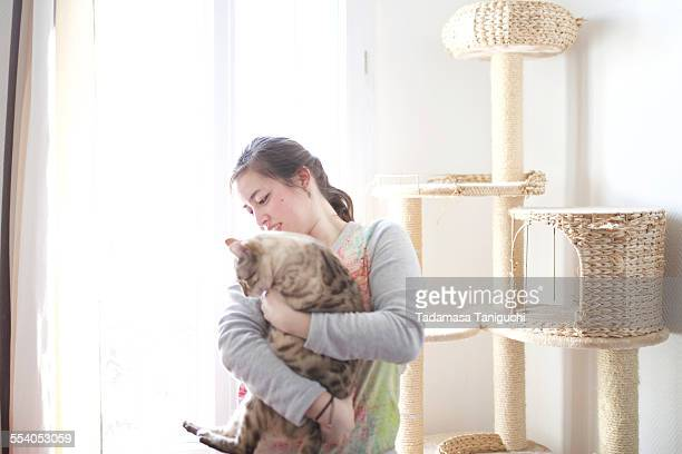 Woman holding her pet cat