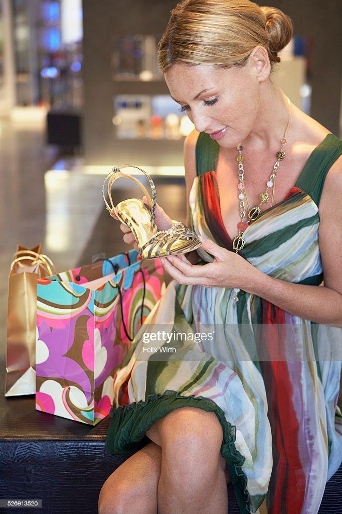 Woman holding high heel : Stock Photo