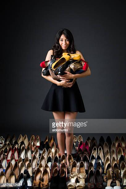 Woman holding high heels