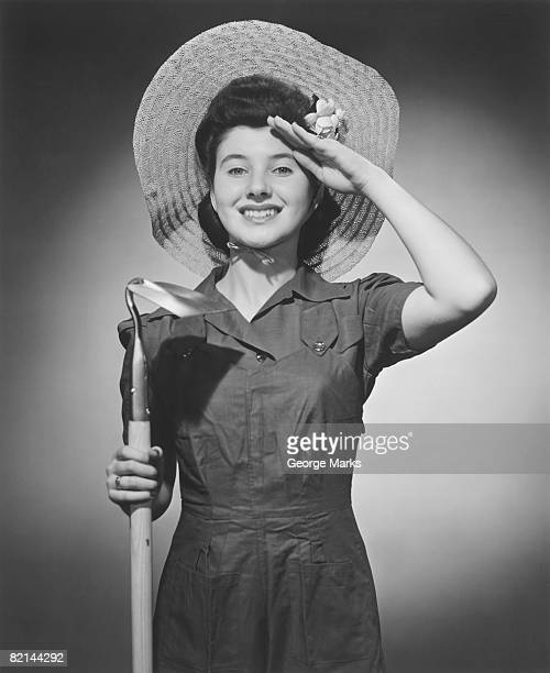 woman holding hoe posing in studio, (b&w), portrait - get your hoe ready stock pictures, royalty-free photos & images