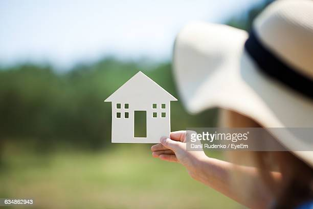 Woman Holding House Model On Sunny Day