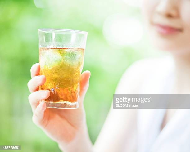 Woman Holding Ice Tea