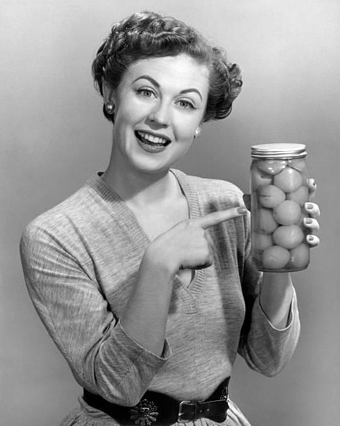 Woman holding jar of fruit