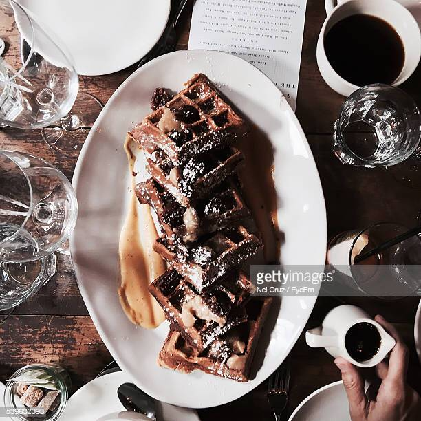Woman Holding Jug With Chocolate Sauce For Waffles