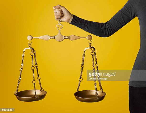 Woman Holding Justice Scale