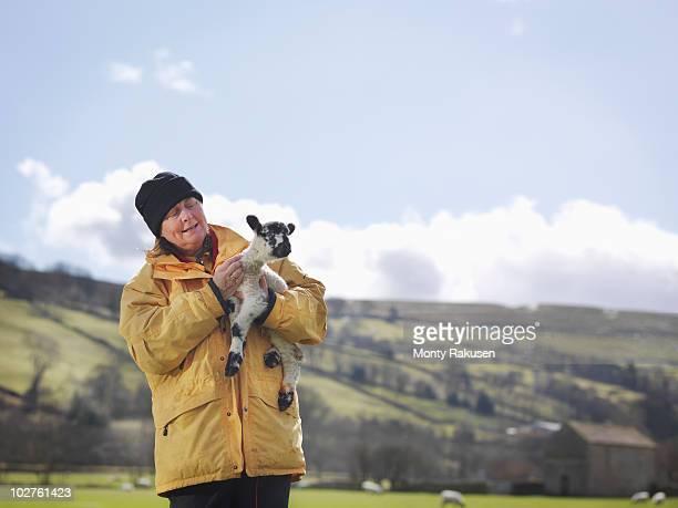 Woman holding lamb