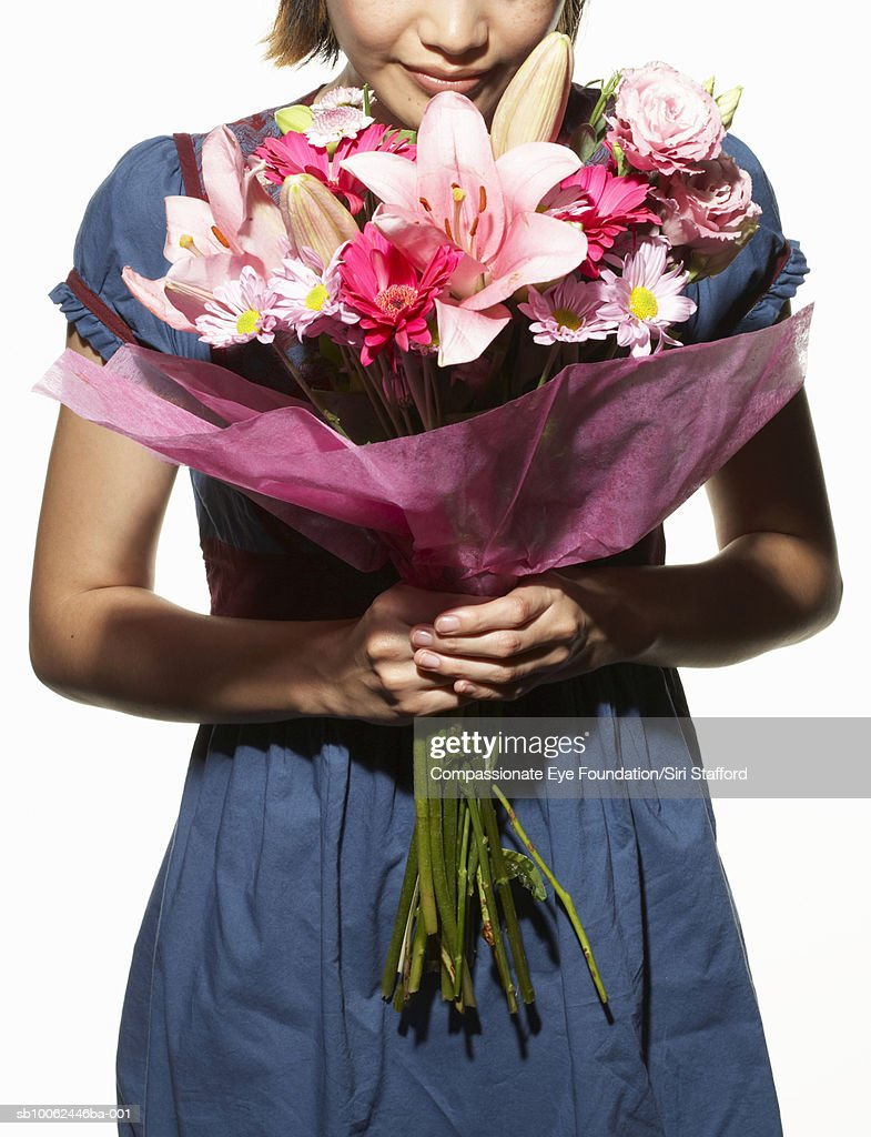 Woman Holding Large Bouquet Of Flowers Mid Section Stock Photo ...