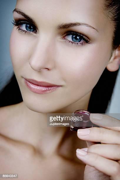 Woman holding lip-gloss