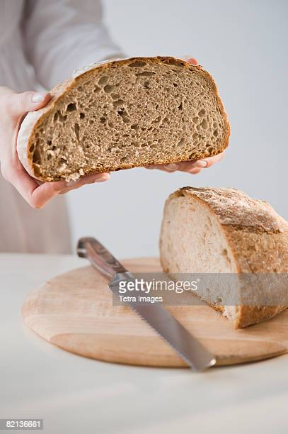 Woman holding loaf of bread
