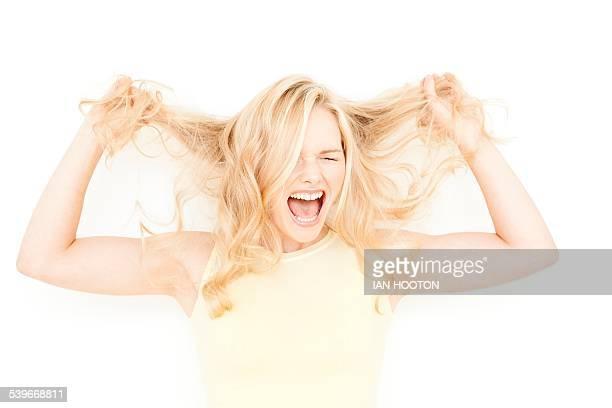 Woman holding long blonde hair