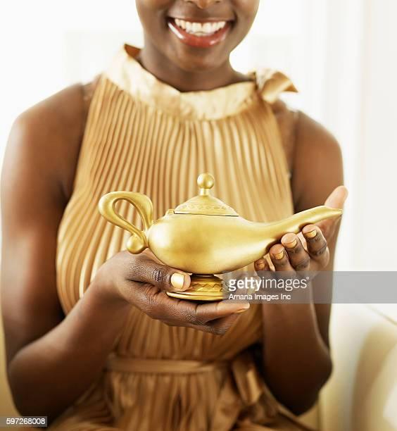 Woman Holding Magic Lamp