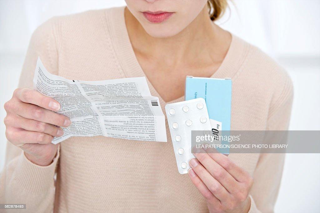 Woman holding medication : Stock Photo