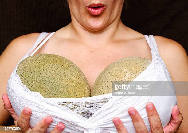 woman holding melons - breast stock pictures, royalty-free photos & images