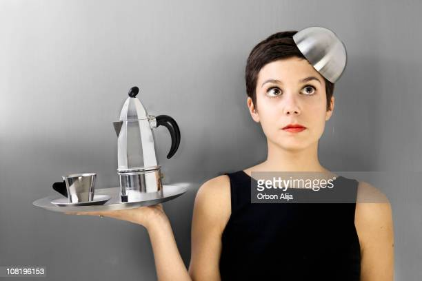 Woman Holding Metallic Coffee-Maker and Cups on Tray