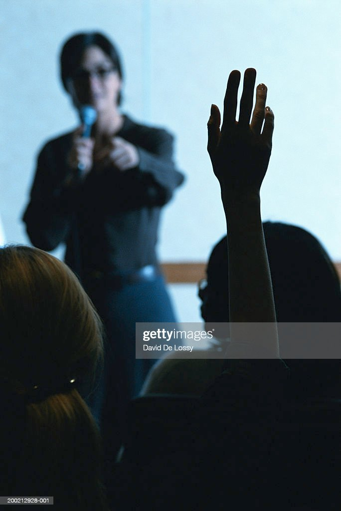 Woman holding mike giving presentation : Stock Photo