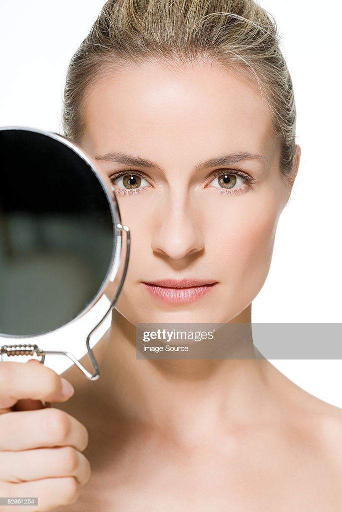 Woman Holding Mirror Stock Photo Getty Images