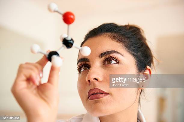 Woman holding molecular model of Ethanol