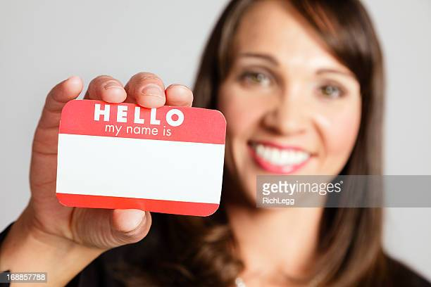 woman holding nametag - name tag stock photos and pictures