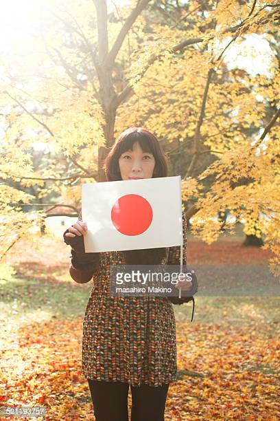Woman Holding National Flag of Japan