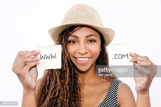 Woman holding notes labeled 'www. .com'