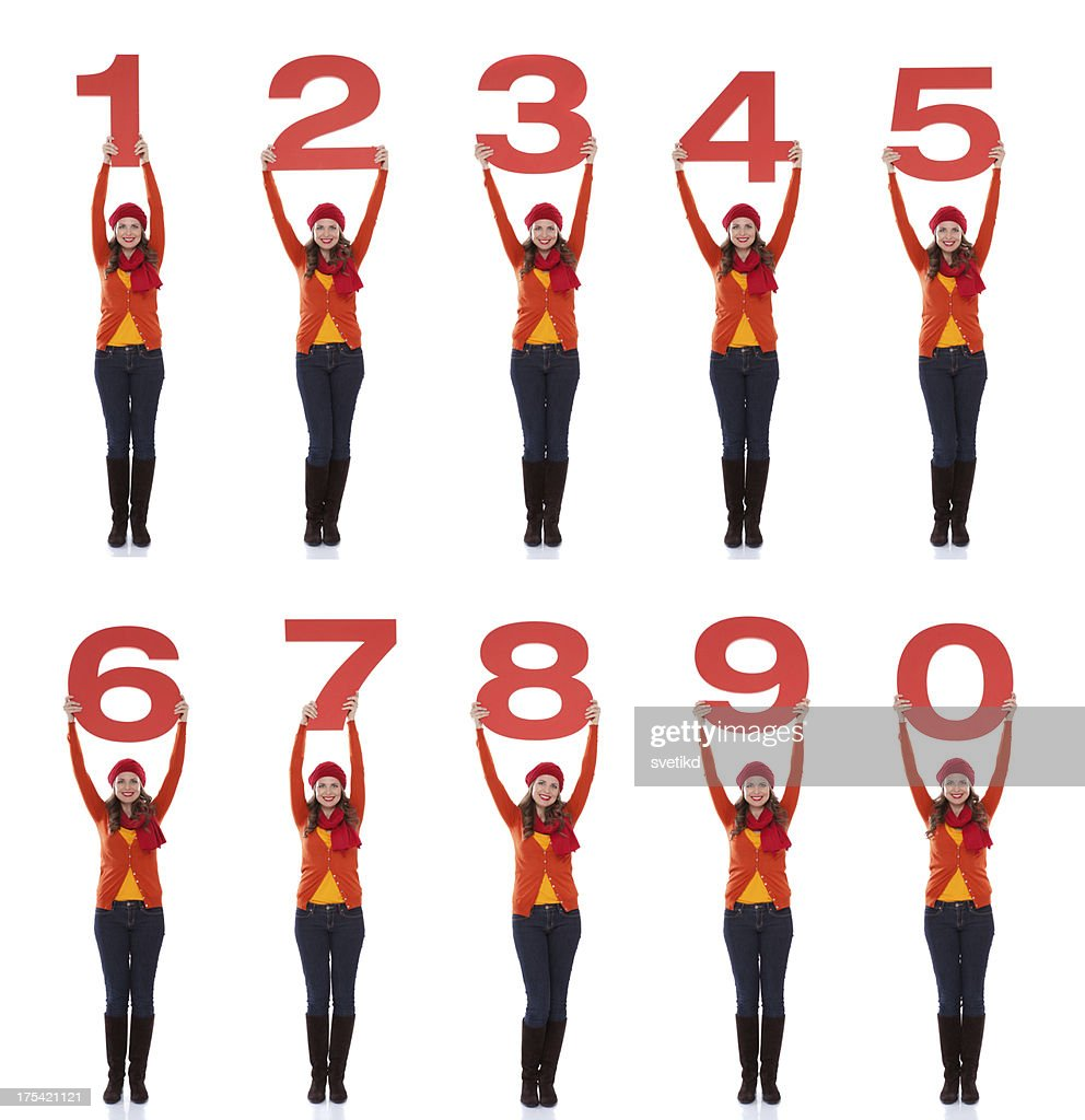 Woman holding numbers. : Stock Photo