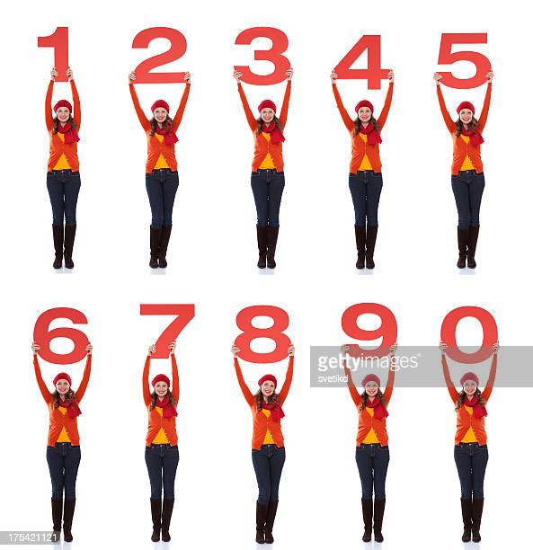 Woman holding numbers.