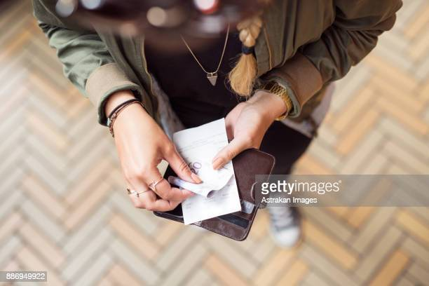 woman holding open wallet with banknotes and receipts - receipt stock pictures, royalty-free photos & images