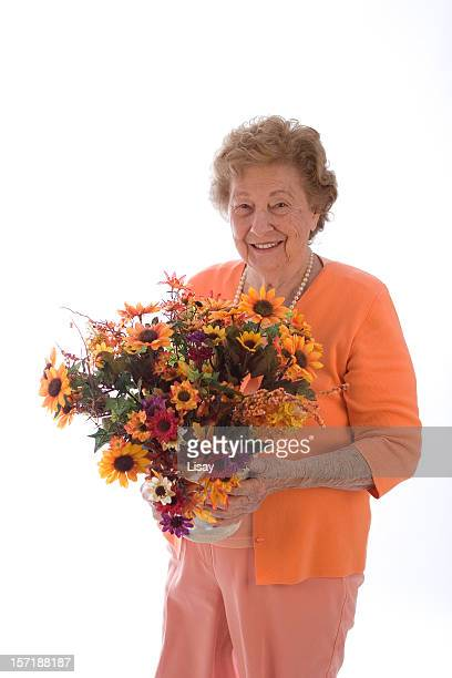 Woman holding orange flowers