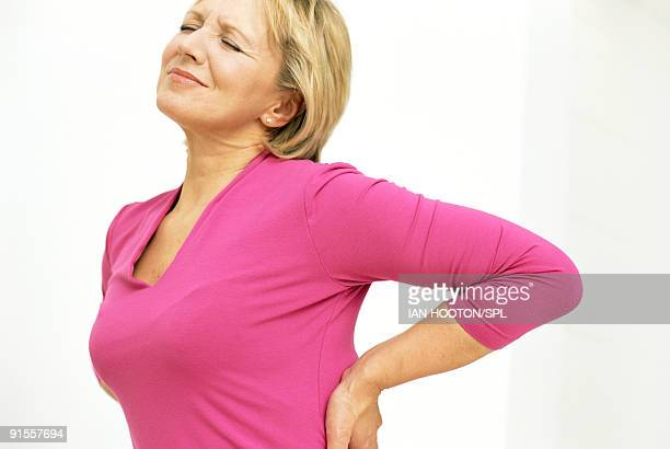 Woman holding painful lower back